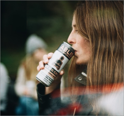 A girl in leather jacket drinking Ablis